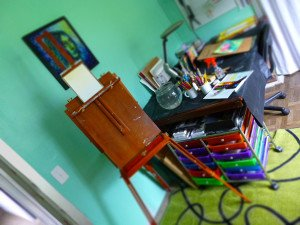 By placing my art supplies between my easel and my sitting area, I can quickly move between the two.